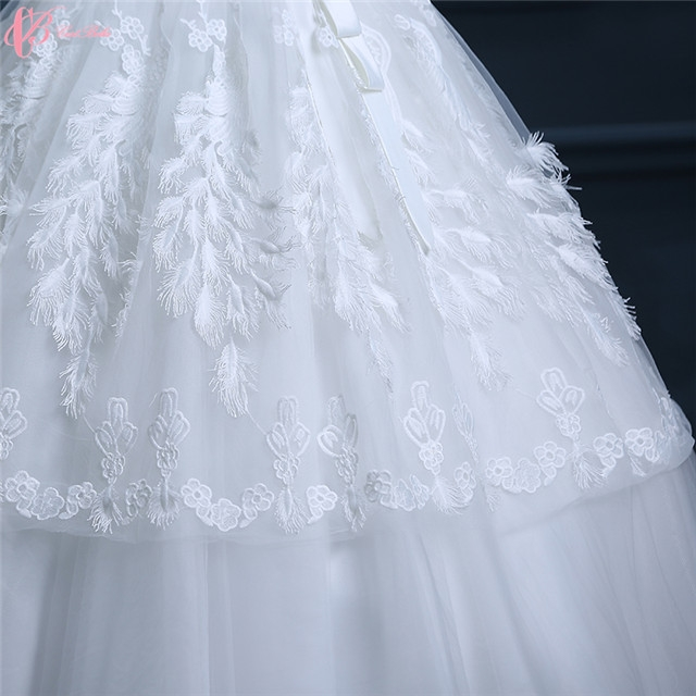 Kilimall guangzhou factory cheap pure white wedding dresses gowns guangzhou factory cheap pure white wedding dresses gowns feather decoration image image image image image image image image image junglespirit Images